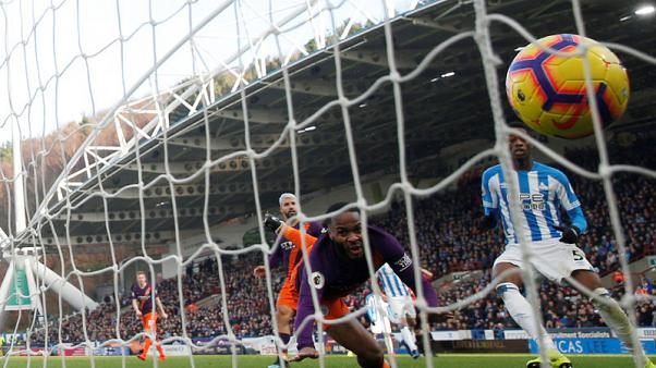 Manchester City ease past Huddersfield to close gap on Liverpool