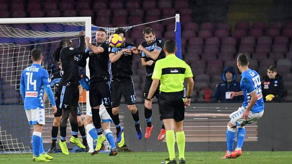 Napoli cling on for win over 10-man Lazio