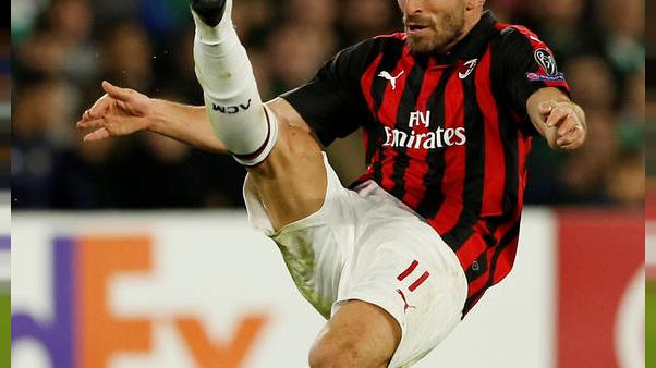 Soccer: Milan move into Champions League places with Genoa win