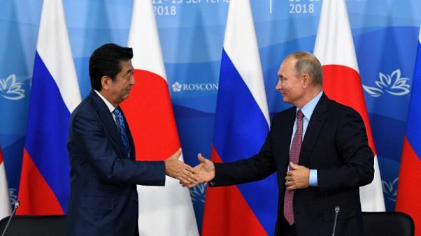 Russia detains 11 protesters ahead of Putin talks with Japan's Abe - monitor