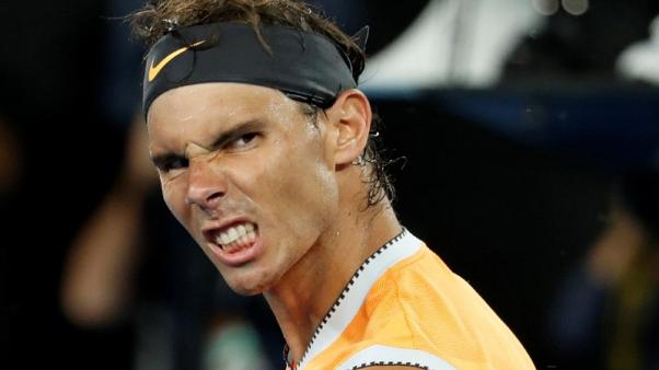 Tennis-Ruthless Nadal sees off Tiafoe to cruise into last four