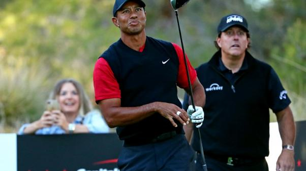 Golf - Tiger plans to make use of new flag rule