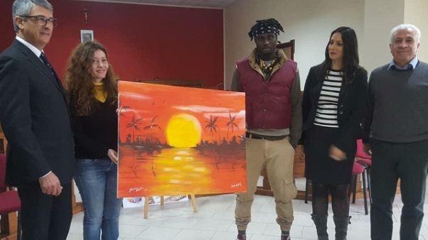 Dipinto a 4 mani migrante e pittrice