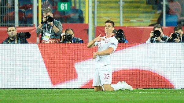 Milan sign Genoa's free-scoring striker Piatek