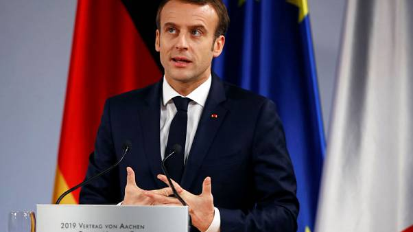 From Italy and within, Macron assailed by political foes