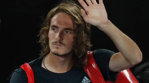 Dejected Tsitsipas bows out leaving Greek fans hoping for more