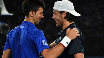 Open d'Australie: Pouille sèchement battu par Djokovic, qui rejoint Nadal en finale