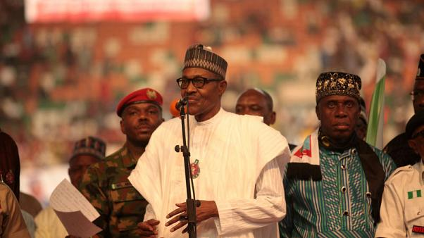 Nigeria's Buhari suspends chief judge, drawing opposition ire before election