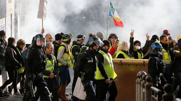 French 'yellow vests' defy Macron with fresh protests