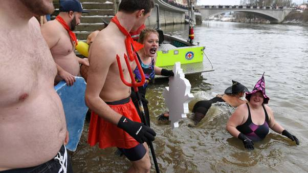 Nearly 2,000 people join annual plunge into icy Danube