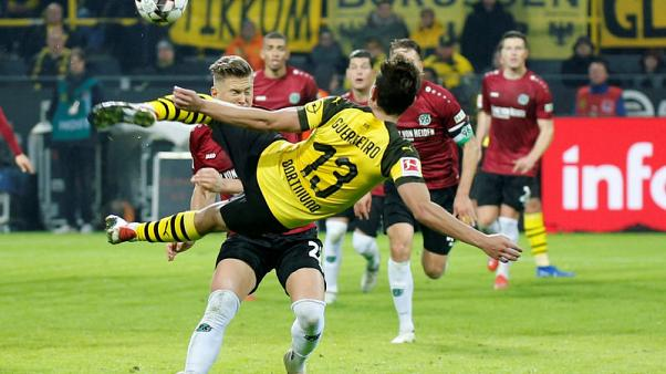 Dortmund beat Hanover 5-1 to go nine points clear
