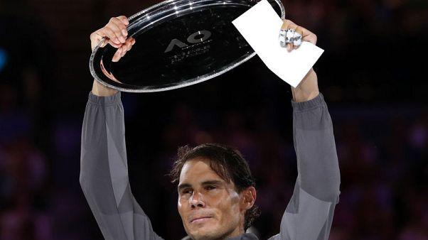 Humbled Nadal says needs 'time, work' to beat Djokovic