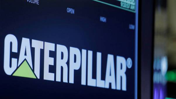 Caterpillar fourth quarter profit misses estimate badly, shares slide
