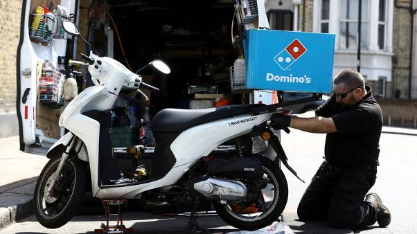 Domino's sees profit at lower end of range, shares down