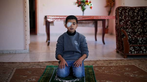 A picture and its story: A boy injured in clashes in Gaza