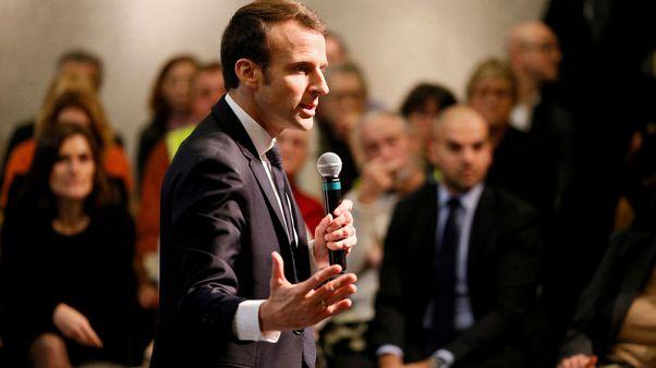 Gloom lifts in Elysee as townhall debates re-energise Macron