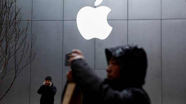 Apple sees U.S.-China tensions easing, services business growing