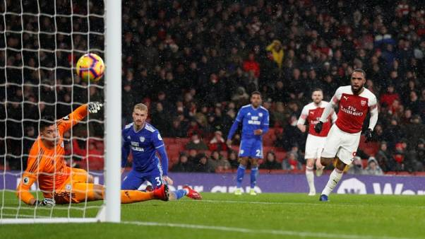 Arsenal beat Cardiff on sombre night amid Sala tributes