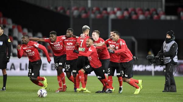 Guingamp beat 10-man Monaco to reach French League Cup final