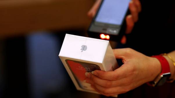 Apple lowers some iPhone prices outside U.S. to offset strong dollar