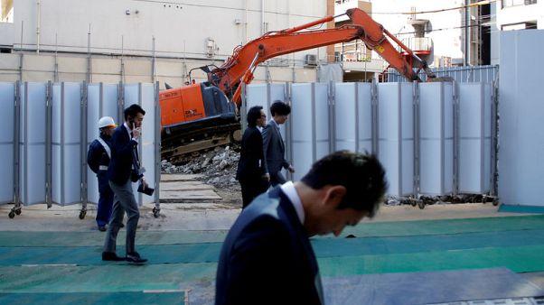 Japan brings forward fiscal surplus target, doubts remain