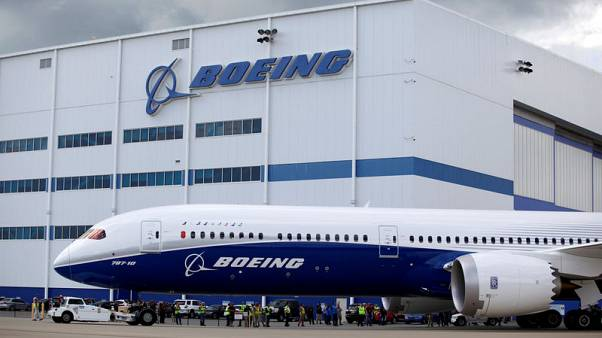 Boeing profit beats; targets 900 plane deliveries in 2019