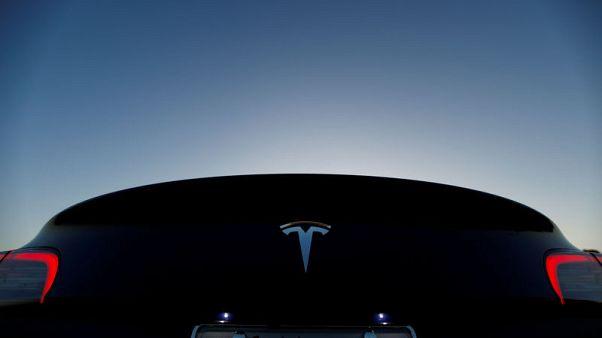 Tesla posts smaller fourth quarter profit than previous quarter