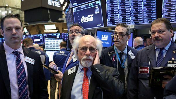 الأسهم الأمريكية تغلق على مكاسب حادة بعد بيان مجلس الاحتياطي