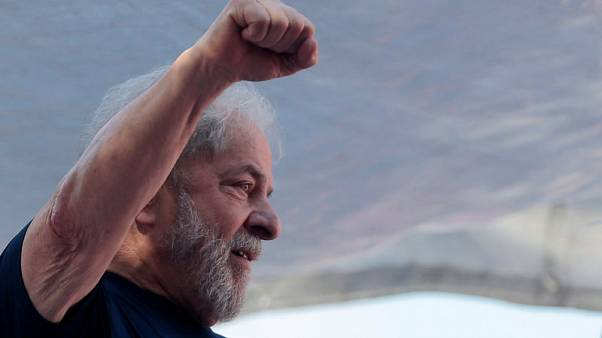 Brazil judge temporarily frees jailed ex-President Lula after brother's death