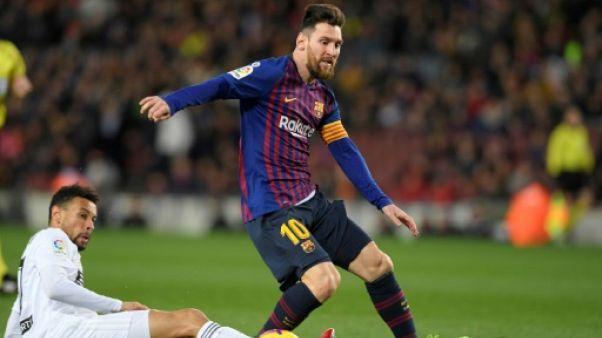 Espagne: Messi, diminué, sauve le Barça contre Valence 2-2