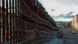 'Disgusting' razor wire must go, say U.S. border city residents