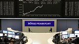 Trade talk optimism helps European shares cling onto October highs