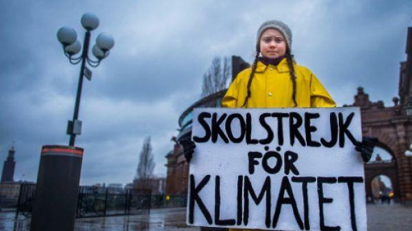 """Climat: une """"étincelle"""" suédoise et des ados par milliers dans les rues"""