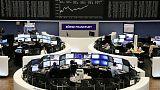 Sainsbury's, Swedbank sink while trade talk progress boosts European shares