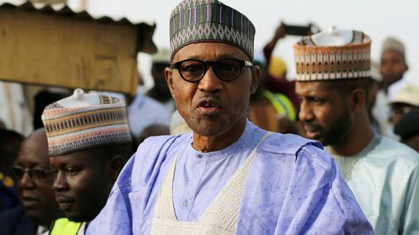 Nigeria's Buhari casts ballot as polls open in delayed presidential election