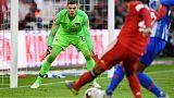 Bayern edge past Hertha to join Dortmund at top