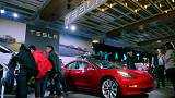 Tesla shares down after surprise Model 3 price drop, store cuts