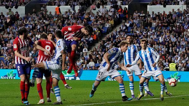 Morata double keeps up 10-man Atletico's Barca chase