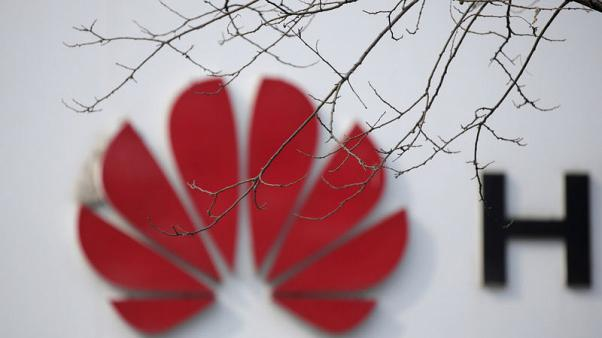 China accuses Canadian, Huawei to sue as spat escalates