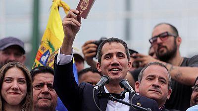 In jab at Maduro, Guaido makes triumphant return to Venezuela