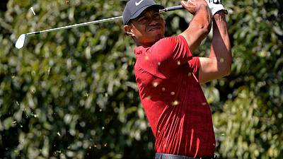 Golf - Tiger withdraws from Arnold Palmer Invitational with neck strain