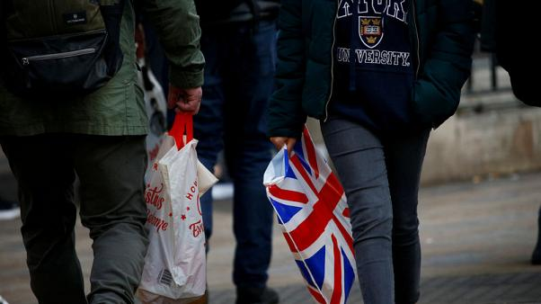 UK shoppers slow their spending ahead of Brexit, some stockpile