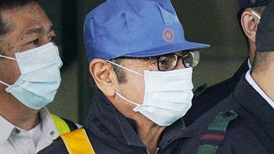 In cap and mask, ousted Nissan boss Ghosn leaves Japan jail after $9 million bail