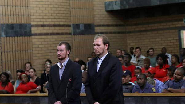 South African court jails two white farmers for killing black teenager