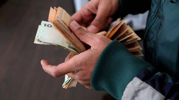 Debts pile up as rival Libyan governments struggle for power