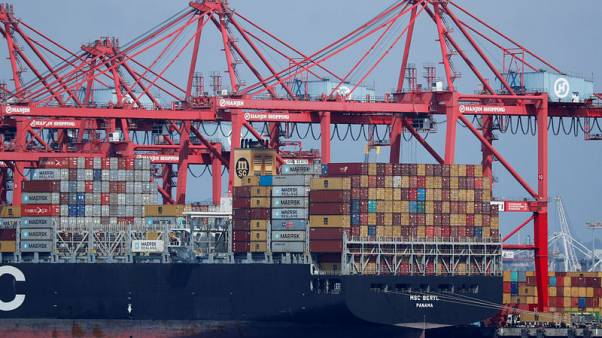 U.S. trade deficit hits 10-year high in 2018 on record imports