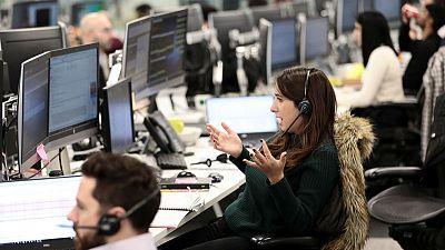 Weak earnings, ex-dividend trading drag FTSE 100 lower