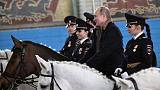Putin rides horse with female police ahead of International Women's Day