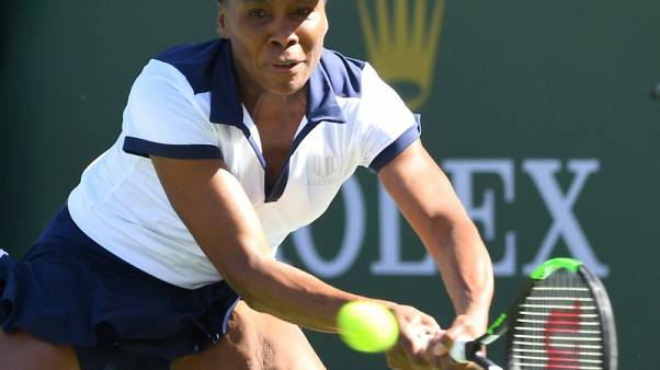 Venus overcomes illness to advance at Indian Wells