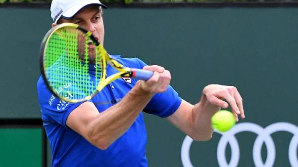 Querrey shakes off sluggish start to advance at Indian Wells